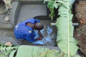 The Water Project: Nguvuli Community, Busuku Spring -  Tile Setting