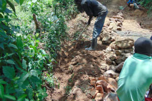 The Water Project: Nguvuli Community, Busuku Spring -  Digging The Cut Off Drainage