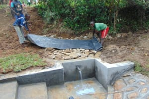 The Water Project: Nguvuli Community, Busuku Spring -  Adding The Tarp Layer