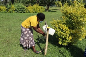 The Water Project: Nguvuli Community, Busuku Spring -  Handwashing Demo Using Tippy Tap