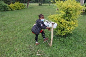 The Water Project: Nguvuli Community, Busuku Spring -  Jamila Demonstrates Handwashing