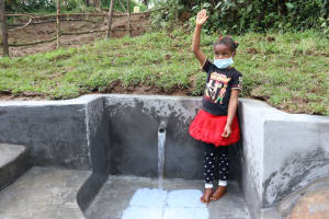 The Water Project: Nguvuli Community, Busuku Spring -  Jamila Offers A High Five For Clean Water