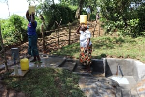The Water Project: Nguvuli Community, Busuku Spring -  Julia And Rosemary Carrying Water