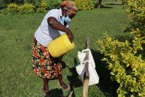 The Water Project: Nguvuli Community, Busuku Spring -  Refilling The Handwashing Station