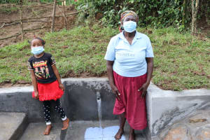 The Water Project: Nguvuli Community, Busuku Spring -  The Smiles Are Behind The Masks