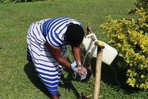 The Water Project: Nguvuli Community, Busuku Spring -  Trainer Betty Demonstrates Handwashing