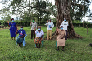 The Water Project: Nguvuli Community, Busuku Spring -  Water User Commitee And Field Officer Karen