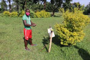 The Water Project: Nguvuli Community, Busuku Spring -  Handwashing Demonstration