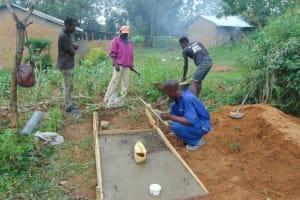 The Water Project: Nguvuli Community, Busuku Spring -  Sanitation Platform Construction