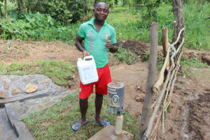 The Water Project: Nguvuli Community, Busuku Spring -  Trained On Refilling Chlorine Dispenser