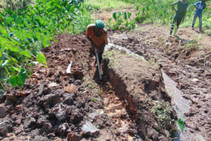 The Water Project: Indulusia Community, Yakobo Spring -  Drainage Channel Opening