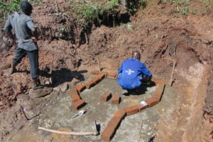 The Water Project: Indulusia Community, Yakobo Spring -  Brick Laying Begins