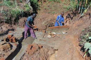 The Water Project: Indulusia Community, Yakobo Spring -  Spring Wall Construction