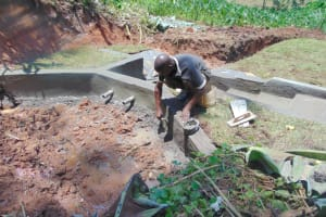 The Water Project: Indulusia Community, Yakobo Spring -  Plastering Interior Headwall