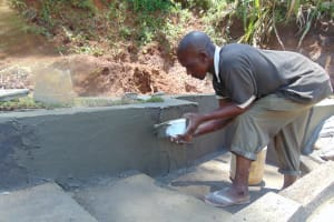 The Water Project: Indulusia Community, Yakobo Spring -  Plastering