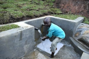 The Water Project: Indulusia Community, Yakobo Spring -  Enjoying Clean Cool Water