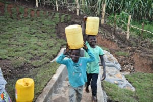 The Water Project: Indulusia Community, Yakobo Spring -  Joy Of Bringing Clean Water Home