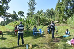 The Water Project: Indulusia Community, Yakobo Spring -  Trainer And County Representative Address The Group