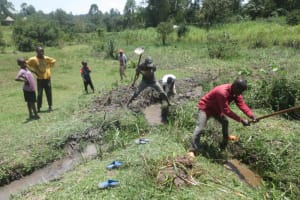 The Water Project: Makale Community, Luyingo Spring -  Digging The Drainage Channel