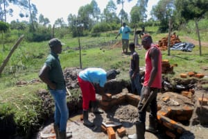 The Water Project: Makale Community, Luyingo Spring -  Wall Brickwork Brgins