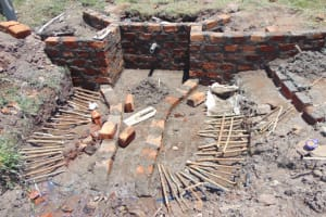 The Water Project: Makale Community, Luyingo Spring -  Water Escape Channels Covered By Sticks