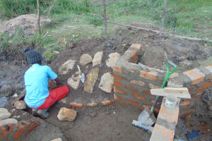 The Water Project: Makale Community, Luyingo Spring -  Rub Wall Construction