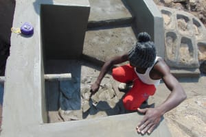 The Water Project: Makale Community, Luyingo Spring -  Tile Setting