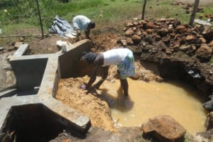 The Water Project: Makale Community, Luyingo Spring -  Backfilling With Clay