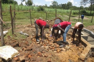 The Water Project: Makale Community, Luyingo Spring -  Backfilling With Stones