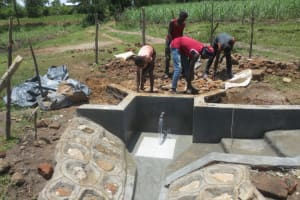 The Water Project: Makale Community, Luyingo Spring -  Backfilling With Stones As Clean Water Begins To Flow