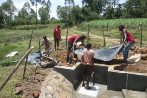 The Water Project: Makale Community, Luyingo Spring -  Laying Pvc Tarp
