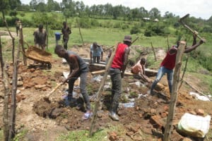 The Water Project: Makale Community, Luyingo Spring -  Backfilling With Soil