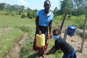 The Water Project: Makale Community, Luyingo Spring -  A Sample Homemade Leaky Tin For Handwashing