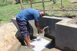 The Water Project: Makale Community, Luyingo Spring -  Enjoying Water