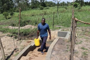 The Water Project: Makale Community, Luyingo Spring -  Erick Carrying Water