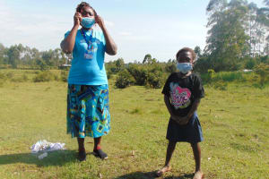 The Water Project: Makale Community, Luyingo Spring -  Trainer Karen Covers Proper Mask Wearing