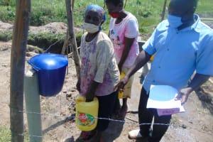 The Water Project: Makale Community, Luyingo Spring -  Using Chlorine Training