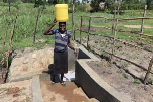 The Water Project: Makale Community, Luyingo Spring -  Heading Home With Clean Water