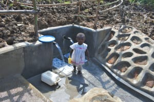 The Water Project: Shitavita Community, Patrick Burudi Spring -  Esther Fetching Water