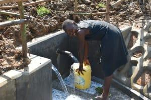 The Water Project: Shitavita Community, Patrick Burudi Spring -  Faith Fetching Water