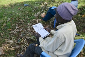 The Water Project: Shitavita Community, Patrick Burudi Spring -  Mr Burudi With Covid Prevention Leaflet