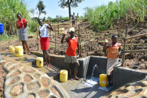The Water Project: Shitavita Community, Patrick Burudi Spring -  Teenagers Celebrating At The Spring