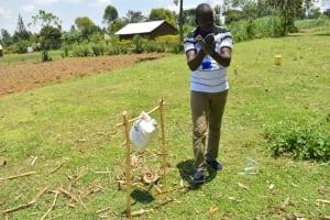 The Water Project: Shitavita Community, Patrick Burudi Spring -  Demonstrating Proper Handwashing