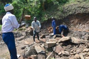 The Water Project: Silungai B Community, Tali Saya Spring -  Brick Toss Teamwork