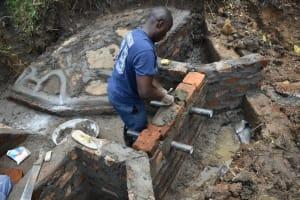 The Water Project: Silungai B Community, Tali Saya Spring -  Pipe Setting