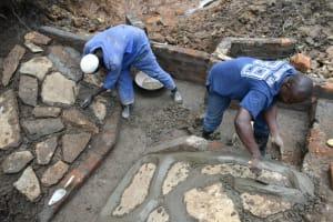 The Water Project: Silungai B Community, Tali Saya Spring -  Stone Pitching