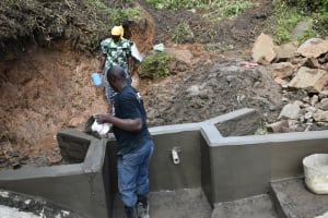 The Water Project: Silungai B Community, Tali Saya Spring -  Plastering