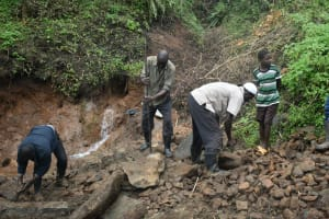The Water Project: Silungai B Community, Tali Saya Spring -  Backfilling With Rocks