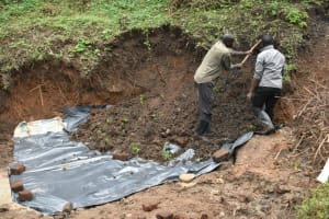 The Water Project: Silungai B Community, Tali Saya Spring -  Backfilling With Soil