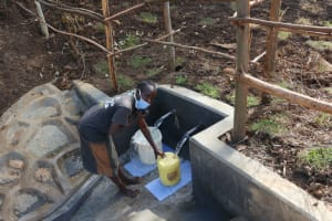 The Water Project: Silungai B Community, Tali Saya Spring -  Collecting Water
